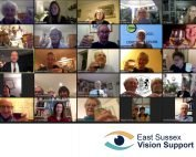 Image shows ESAB members, Chairman, Trustees and associates raising a glass on Zoom