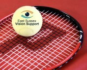 Image shows a tennis racket with a Sound tennis ball balanced on top